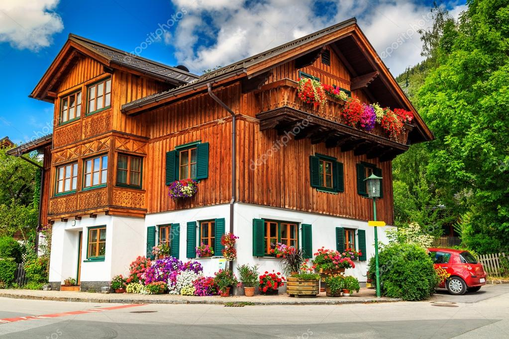 Traditional Alpine House With Flowers On BalconyAustriaEurope Stock Photo