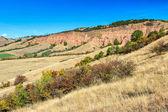 Il canyon rosso e pittoresco paesaggio di autunno, Sebes, Transilvania, Romania