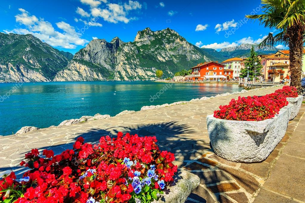 Red flowers and promenade,Lake Garda,Northern Italy,Europe