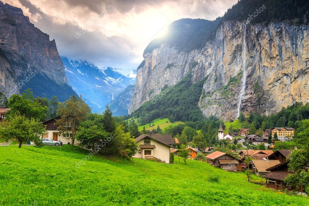 Famous Lauterbrunnen town and Staubbach waterfall,Bernese Oberland,Switzerland,Europe