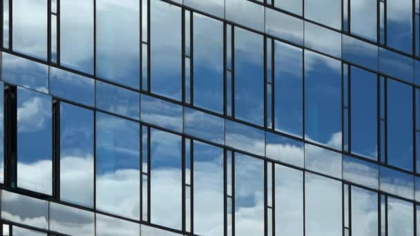 Time lapse of and office building facade reflecting the summer sky