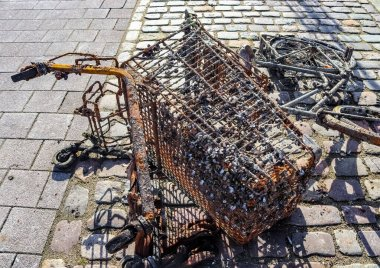Rusty and damaged shopping cart found in the port of Kiel in Germany