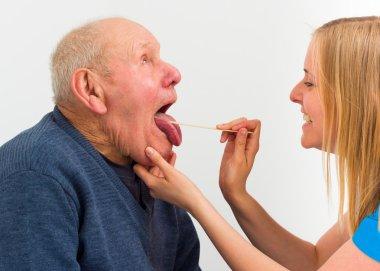 Elderly man with pharyngitis at the hospital, for medical exam. stock vector
