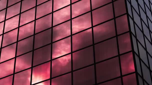 Changing color of dense clouds reflecting in modern building