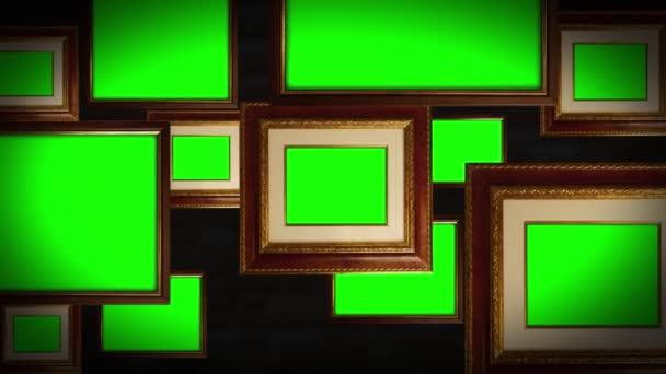 Bilderrahmen mit grünem Chromakey-Raum hängen an Ziegelwand