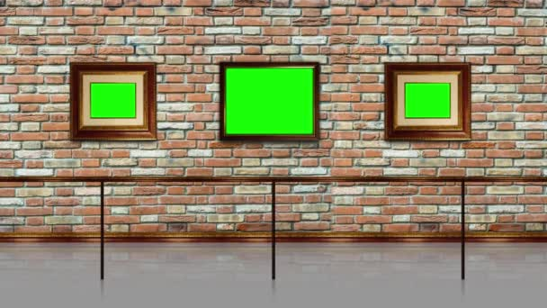 Picture frames with green chromakey space hang on brick wall