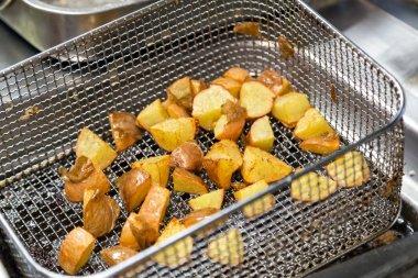 deep fryer with fried potato