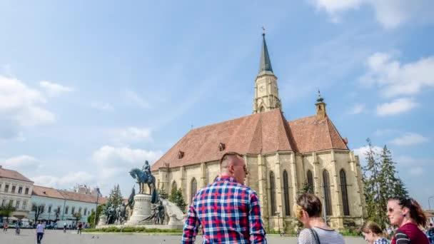 Saint Michael Church and Matei Corvin Statue in Unirii Square in Cluj Napoca