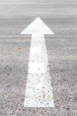 White traffic arrow signage
