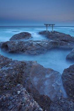 At sunrise, many large waves
