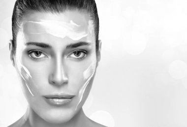 Beautiful Spa Girl with Cream on Her Face. Skincare concept