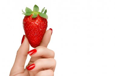 Female Hand Holding a Luscious Ripe Strawberry Isolated on White