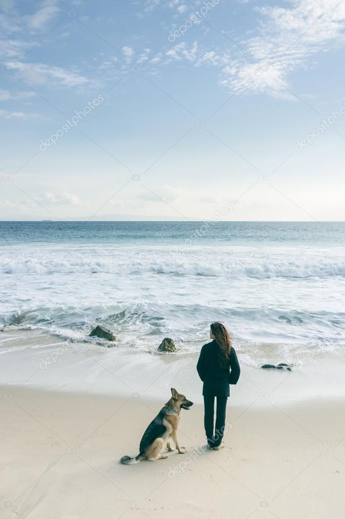 Woman with her dog at the beach