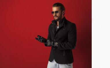 Man in black coat wears gloves