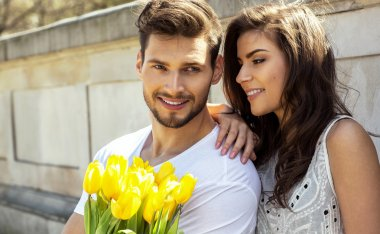Couple with bouquet of tulips