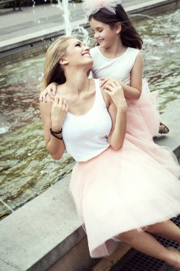 Mother and daughter in same outfits weared tutu skirts