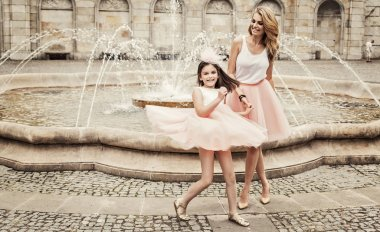 Mother and daughter having fun in same outfits weared tutu skirt