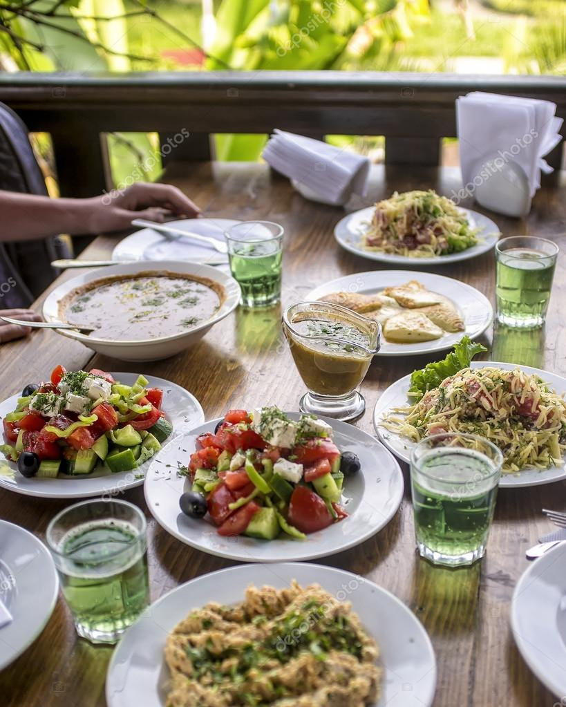 Lunch in the open air the cafe with lots of food and for Abkhazian cuisine