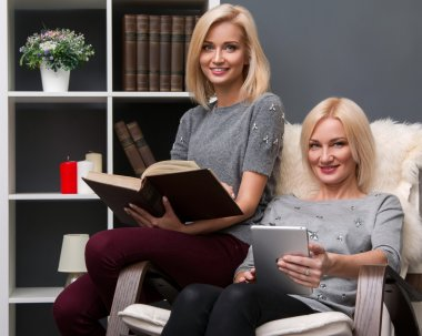 Mother and daughter with  books