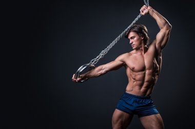muscular man with metallic rings