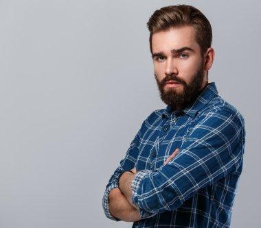 bearded man in checkered shirt