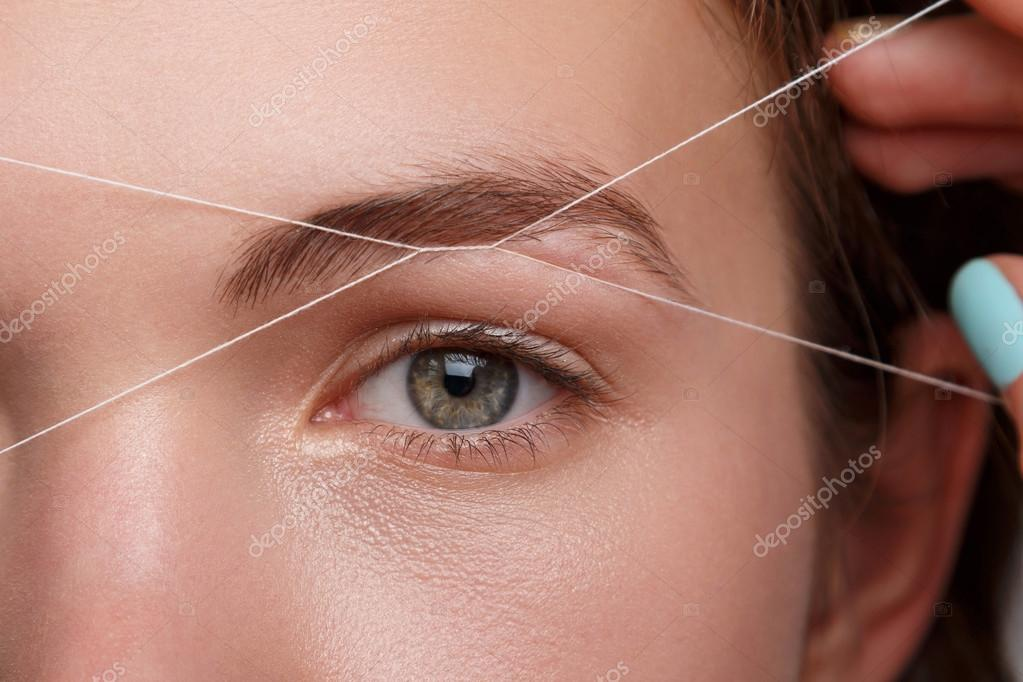 Eyebrow threading is a traditional hair removal technique Quick and painless eyebrow threading is done by