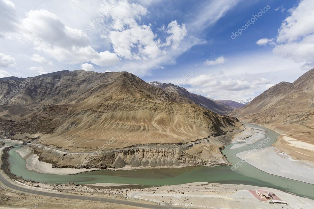 Top view of confluence of rivers Indus and Zanskar looks enticing from hill road going towards Nemo village.Leh Ladakh, India