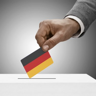 Black male holding flag. Voting concept - Germany