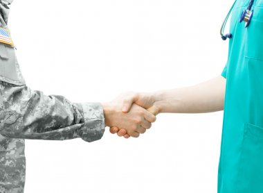 Soldier and doctor shaking hands on white background