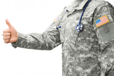 US Army doctor showing thumb up - studio shot