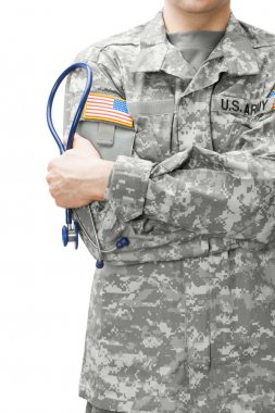 US Army doctor holding stethoscope next to his shoulder