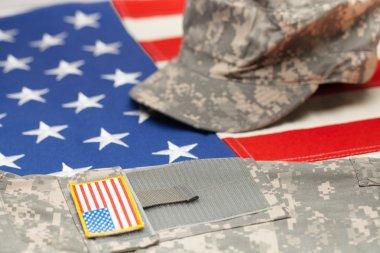 USA flag with US military uniform over it - studio shot