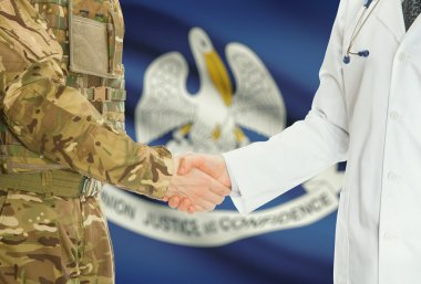 Military man in uniform and doctor shaking hands with US states flags on background - Louisiana