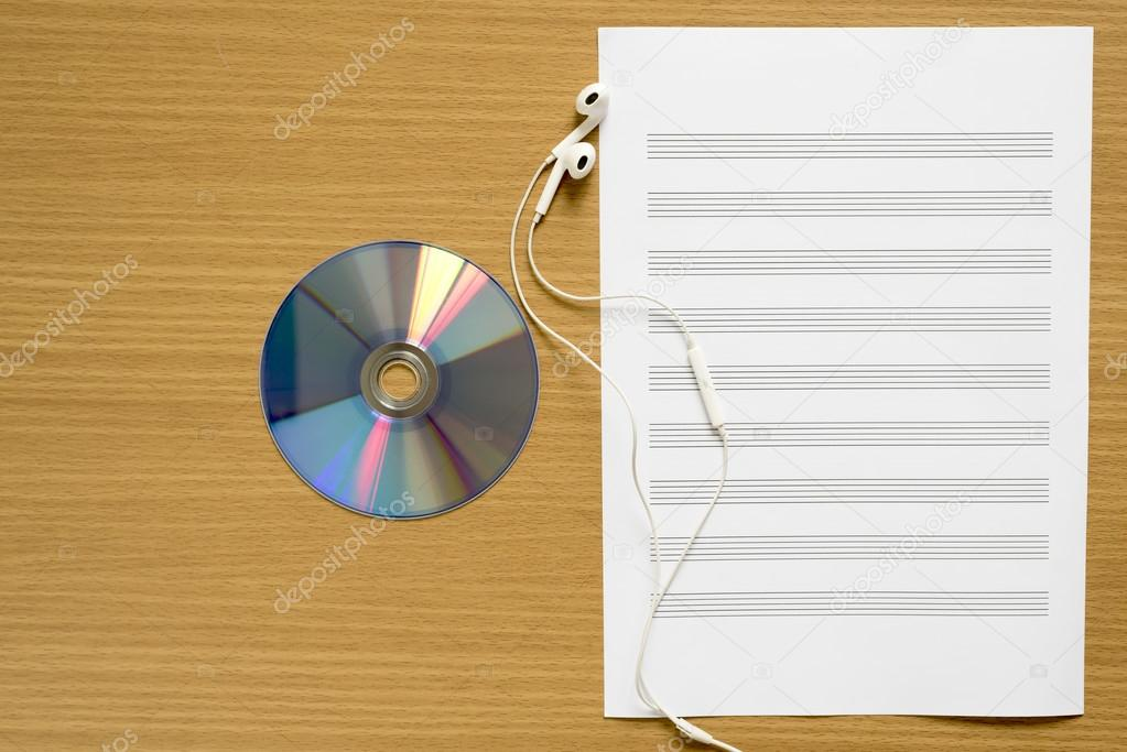 Top View Of Music Staff Paper Dvd Dish And Earphone Stock Photo
