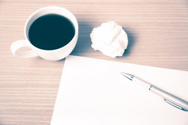 Crumpled paper and coffee cup