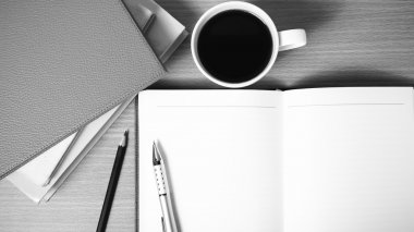 open notebook with book and coffee cup  black and white color to