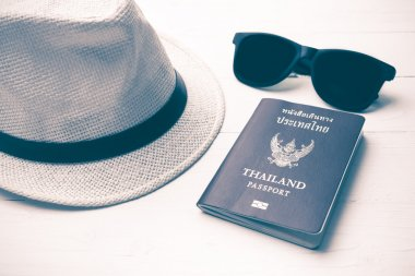 hat sunglasses and passport vintage style