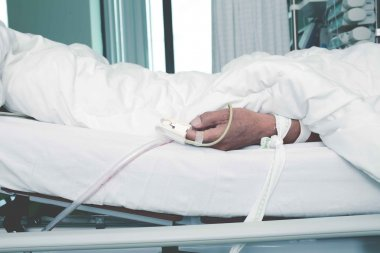 Patient tied to a bed in the critical care unit