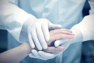 Hands of the doctor and patient