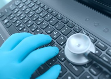 Doctor's hands on keyboard while working in the hospital