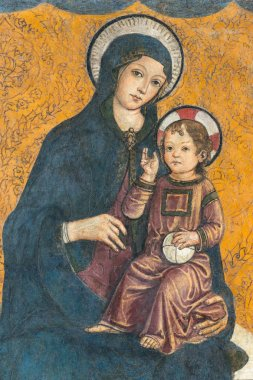 Medieval fresco of Madonna and child