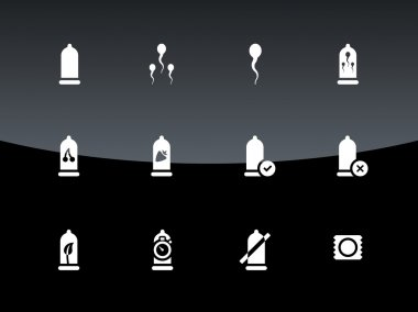 Condom and sperm icons on black background.