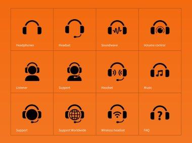 Earphones icons on orange background.
