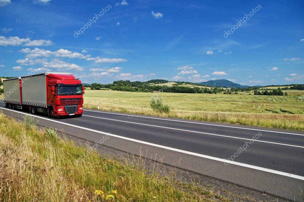Rural landscape with road you are driving a red truck