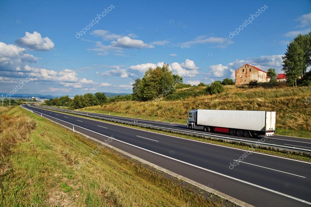House of highway in a rural landscape, truck on the road