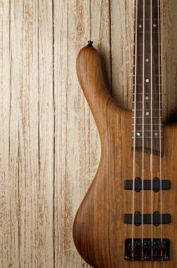 bass guitar on wood