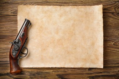 old parchment with pistol