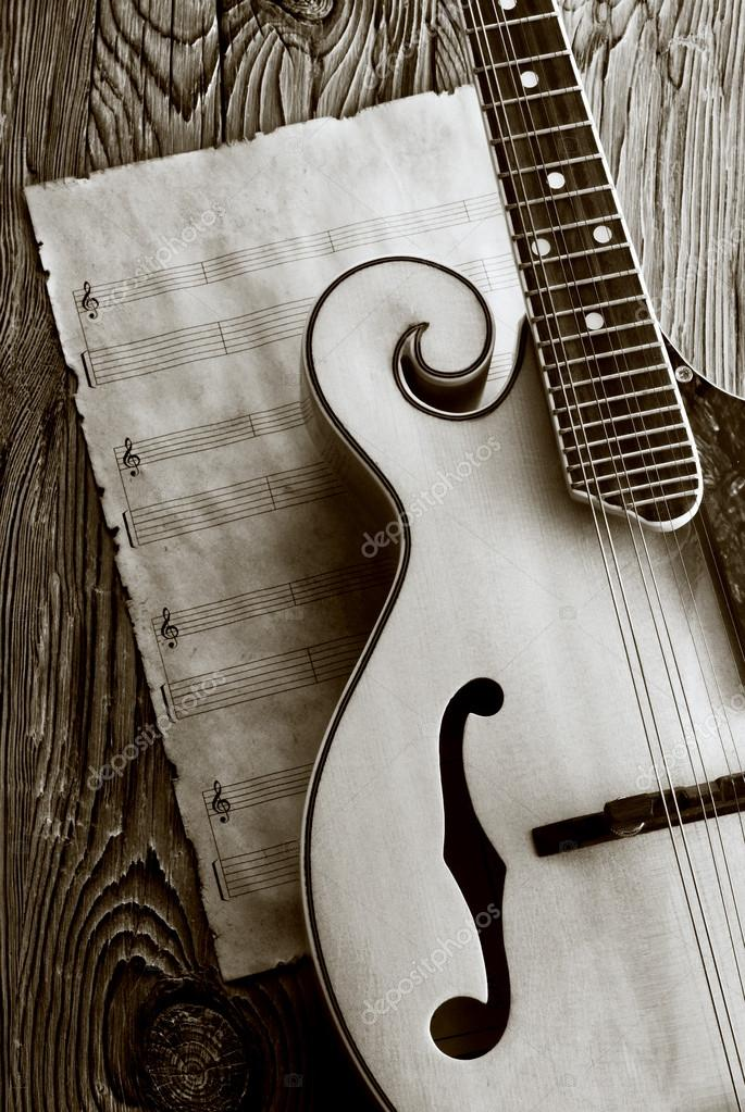 mandolin with music sheet