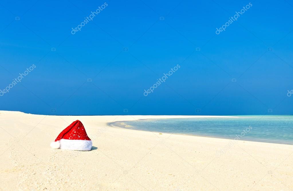 Santa hat is on a beach