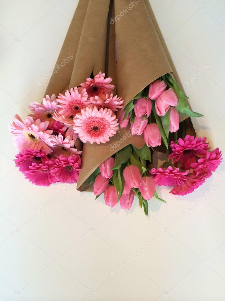 Wrapped flower bouquets stock photo mbudley 67674213 variety of pink flowers wrapped in brown paper photo by mbudley mightylinksfo